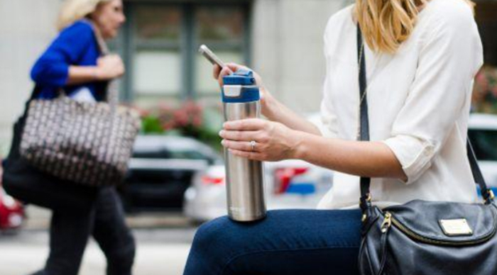 holding contigo autoseal chill while texting